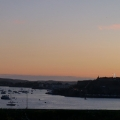 Sun setting across Plymouth