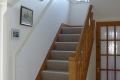 Main staircase at Sandays B&B